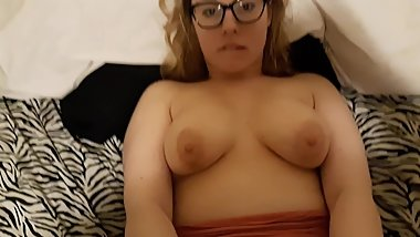 Glasses wearing wife takes thick facial.